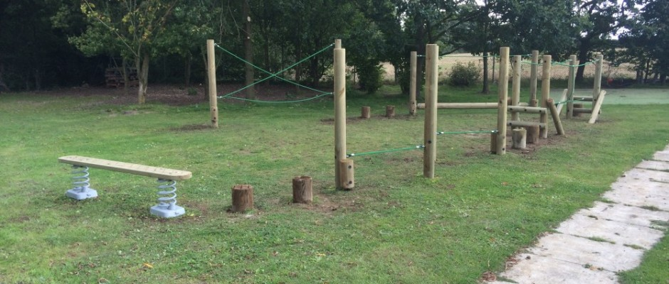 """Trim Trails are, in effect, """"Junior Assault Courses"""" – with their origins traceable back to military training facilities used in the 1970's. The Trim Trails installed by Groundplay Limited are of course considerably less strenuous to complete(!) – and have become extremely popular additions to public play areas and park[...]"""